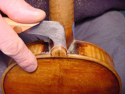 提琴肩钮加层的修复方法